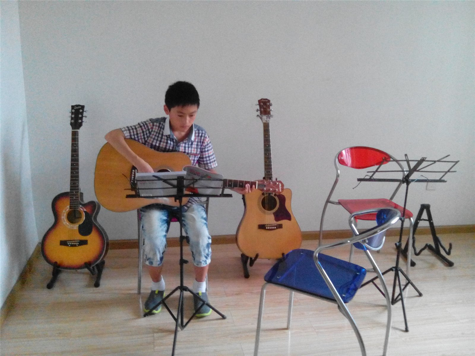 崇州/主题: 最优惠的吉他教学崇州风行音乐教室
