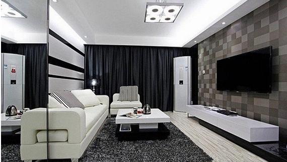 客廳白色的沙發和茶幾,灰色柔軟舒適的地毯,黑白條紋裝飾的背景墻.